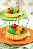 Dessert tartlet with  cocktail cherries Stock Photography