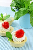 Dessert tartlets with cream and cherry Royalty Free Stock Photo