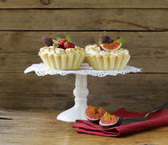 Dessert tartlets from shortcrust pastry with meringue Royalty Free Stock Images