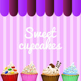 Dessert theme with decorated cupcakes Royalty Free Stock Photos