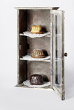 Dessert three ring cakes. In an old vitrine Royalty Free Stock Photos