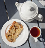 Dessert time - tea and cake. Delicious fruit cake served with a cup of tea served outdoors Stock Photo