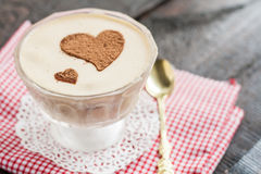 Dessert tiramisu decorated with hearts on a red napkin and a gol Royalty Free Stock Photography