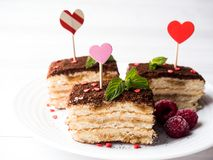 Dessert Tiramisu with mint and fresh raspberries on white wooden table. Red hearts Valentine`s Day.  Stock Photography