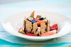 Dessert with tonka cream, chocolate and berries Stock Photos