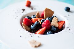 Dessert with tonka cream, chocolate and berries Royalty Free Stock Images