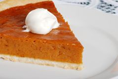 Dessert topping on pumpkin pie focus on whip cream Stock Photography