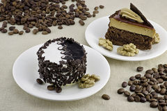 Dessert. Two beautiful cakes with walnuts and coffee beans Royalty Free Stock Image