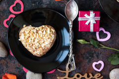 Dessert for Valentine's day celebration on black plate. Stock Photography