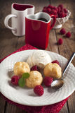 Dessert with Vanilla Ice Cream and Puff pastry filled with dairy creamam. Dessert with Vanilla Ice Cream and Puff pastry filled with dairy cream and two cups of Royalty Free Stock Photo