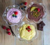 Dessert variation chocolate cream raspberry cream vanilla cream Stock Image
