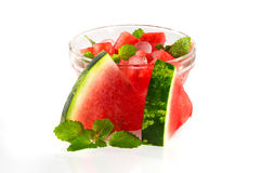 Dessert with a watermelon with leaflets of mint. Stock Image