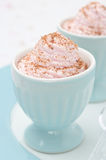 Dessert of whipped cream topped with grated chocolate closeup Stock Images