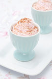 Dessert of whipped cream topped with grated chocolate closeup ve Royalty Free Stock Photography