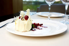 Dessert of white chocolate and wild berries. On a table Royalty Free Stock Image
