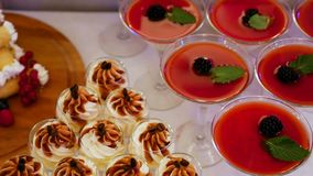 Dessert white red Jell-o in the glass in the triangle. Martini with berries stock video footage