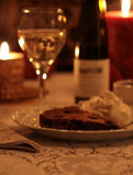 Dessert and Wine By Candlelight. Delicious Linzer torte with whipped cream, served with a sparkling dessert wine in a luxurious setting with romantic golden Stock Images