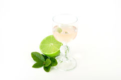Dessert wine with lime. And leaves isolated on white Stock Photos