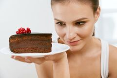 Dessert. Woman Eating Chocolate Cake. Portrait Of Beautiful Happy Smiling Girl With Piece Of Tasty Sweet Cake On Plate. Food And Nutrition Concept. High Royalty Free Stock Photography