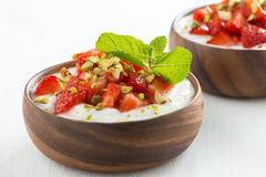 Dessert of yogurt with fresh strawberries, pistachios and mint Royalty Free Stock Photography