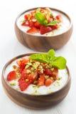 Dessert of yogurt with fresh strawberries, pistachios and mint Stock Photos