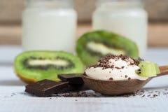Dessert. yogurt with fruit and chocolate Kiwi chocolate yogurt royalty free stock photos