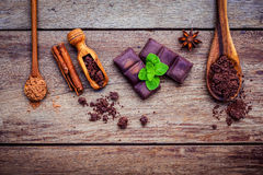 Desserts background and menu design. Ingredients for bakery ,cho. Colate bar ,chocolate powder ,star anise and cinnamon sticks setup on shabby  wooden background Royalty Free Stock Photography
