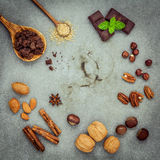 Desserts background and menu design. Ingredients for bakery , pe. Can, almonds,hazelnut ,walnut ,chocolate bar ,star anise ,cinnamon sticks and brown sugar setup Royalty Free Stock Photography