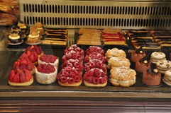 Desserts in bakery window stock images