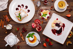Desserts with berries and tea Royalty Free Stock Image