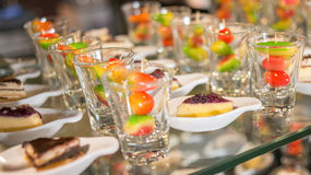 Desserts. The colorful plating and blueberry cake served on a party stock photos