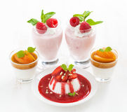 Desserts with cream jelly and fresh berries Stock Photos