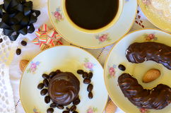 Desserts with cup of coffee, coffee beans and almonds on white tablecloth Stock Photography
