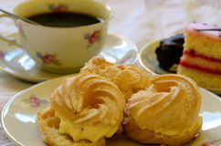 Desserts with cup of coffee on white tablecloth Stock Photos