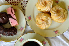 Desserts with cup of coffee on white tablecloth Stock Photography
