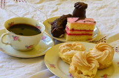 Desserts with cup of coffee on white tablecloth Stock Photo