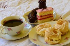 Desserts with cup of coffee on white tablecloth Royalty Free Stock Photos