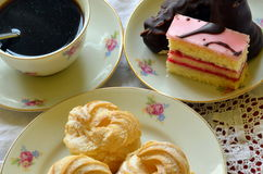 Desserts with cup of coffee on white tablecloth Royalty Free Stock Photo