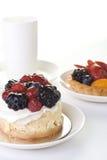 Desserts en een kop stock afbeeldingen