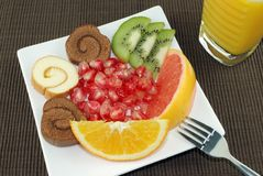 Desserts and Fruits. Mixed Set of Desserts,Fruits and Juice Isolated on brown tablecloth Stock Photography