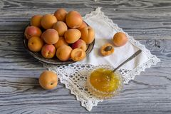 Apricots and apricot jam on a wooden table royalty free stock photos
