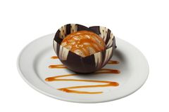 Desserts. Isolated caramel icecream in a chocolate and vanilla cup Royalty Free Stock Image