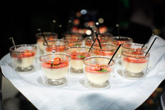 Desserts panna cotta with strawberry in glasses Royalty Free Stock Images