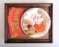 Desserts and red packet for Chinese new year Royalty Free Stock Images