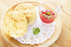 Desserts scones and strawberry jam on wood. Stock Image