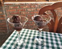 DECADENT CHOCOLATE DESSERT. Desserts served in martini glasses on traditional checkered green and white table cloth in Italian restaurant in Montecristi Ecuador Royalty Free Stock Photos
