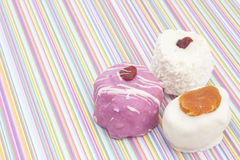 Desserts on striped background Royalty Free Stock Images