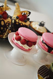 Desserts. Table with macaroons, chocolate cookies and tarts Stock Photos