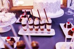 Layered yogurt dessert in glasses stock photo