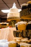 Desserts at a wedding focusing in on cupcakes. At a wedding reception Royalty Free Stock Image